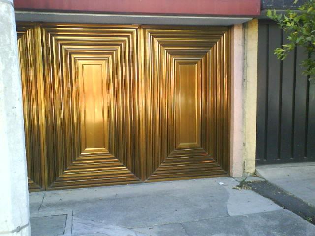 Port n de aluminio bronce claro herreria y aluminio san for Ventanas de aluminio color bronce
